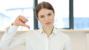 Thumbs down, woman in office stock video