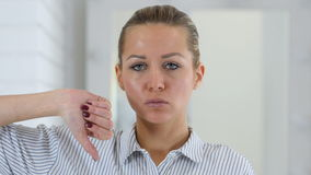 Thumbs down, woman portrait in office stock video footage