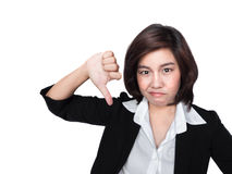 Thumbs down woman unhappy and negative giving disapproval. Thumbs down  businesswoman unhappy and negative giving disapproval hand sign Royalty Free Stock Photo