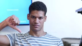 Thumbs Down by Young Black Man stock footage