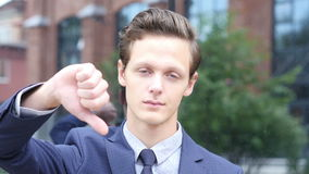Thumbs Down by Young Businessman, Portrait. Creative designer , businessman stock footage