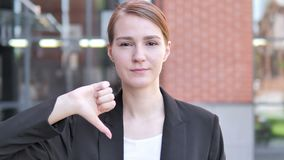 Thumbs Down by Young Businesswoman, Outdoor. 4k high quality, 4k high quality stock video footage