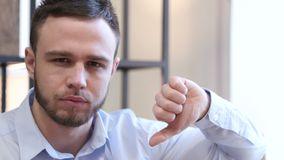 Thumbs Down by Young Man. Young creative designer , good looking stock video footage