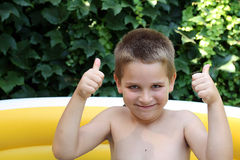 Thumbs up. This is my son Igor with thumbs up Royalty Free Stock Photo