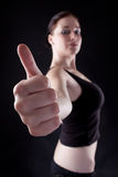 Thumbs up. Attractive caucasian girl showing thumbs up. Image isolated on black background Stock Photos