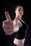 Thumbs up. Attractive caucasian girl showing thumbs up. Image isolated on black background Stock Images