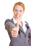 Thumbs up. Blond happy businesswoman in a suit holding her thumb up royalty free stock photos
