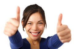 Thumbs up. Very excited young mixed caucasian / asian woman giving . Shallow depth of field, focus on face Stock Photo