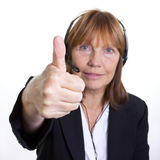 Thumbs up. Older senior business woman's arthritic hand with knobbly fingers in a Thumbs Up hand gesture Royalty Free Stock Images