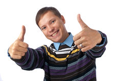Thumbs Up. Young man giving an energetic thumbs up Stock Photography