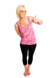 Thumbs up. Woman in pink and black giving a thumbs up Royalty Free Stock Photography