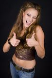 Thumbs Up. Female showing two thumbs up winking Stock Photography