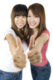 Thumbs up. Young Asian University student giving thumbs up sign Stock Photography