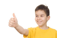 Thumbs up. Happy boy showing thumbs up sign stock photo