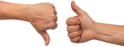 Thumbs up. Two male hands with thumbs up and down on white background Royalty Free Stock Photography