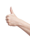 Thumbs up. An isolated to white image of a fist/punch hand signal Royalty Free Stock Images