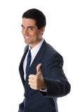 Thumbs up!. Man in blue suit giving a thumbs up royalty free stock image