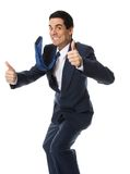 Thumbs up!. Crazy businessman in blue suit doing the thumbs up stock photos
