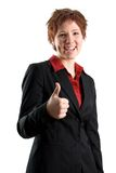 Thumbs up!. Woman in a black jacket with thumbs up royalty free stock images