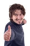 Thumbs up. Young man smiling with thumb up Stock Photography