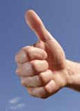 Thumbs up. Against blue sky stock image