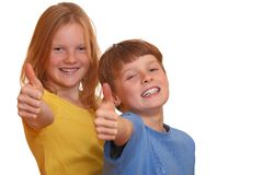 Thumbs up. Two happy kids show thumbs up isolated on white background Royalty Free Stock Photo