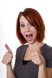 Thumbs Up. Redhead woman gives the thumbs up of approval Royalty Free Stock Photos