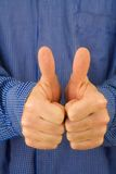 Thumbs Up!. A man give two thumbs up, a traditional gesture indicating, OK, success, congratulations, well-done, approval, etc stock photography