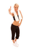 Thumbs Up. A young female dressed in gym clothes giving the thumbs up sign with one hand Royalty Free Stock Photography