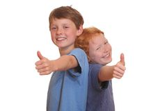 Thumbs up. Two happy young kids with thumbs up Stock Photos