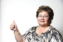 Thumbs up. A 60 year old Hispanic woman giving the thumbs up gesture Stock Image