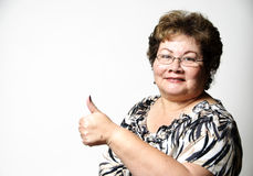 Thumbs up. A 60 year old Hispanic woman giving the thumbs up gesture Royalty Free Stock Photo