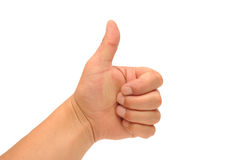 Thumbs up. Photograph of a human hand using the thumbs up sign, for good Royalty Free Stock Photography