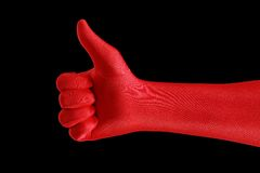 Thumbs up!. A strange gloved hand making a  thumb up gesture Royalty Free Stock Photos