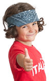 Thumbs Up. Young girl with headband smiling with thumbs up stock photo