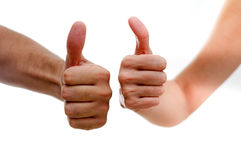 Thumbs up. Man and woman hands showing thumbs up sign isolated on white background Royalty Free Stock Photography
