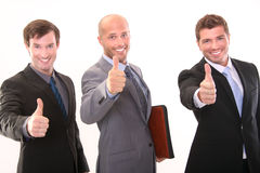 Thumbs up!. Three businessmen gesturing thumb up sign Stock Photography