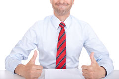 Thumbs up. A business man giving his thumbs up Royalty Free Stock Image