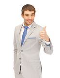 Thumbs up. Bright picture of handsome man with thumbs up Stock Photos