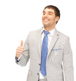 Thumbs up. Bright picture of handsome man with thumbs up Stock Image