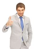 Thumbs up. Bright picture of handsome man with thumbs up Royalty Free Stock Images