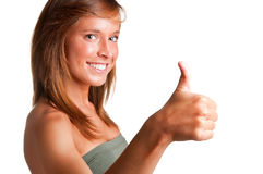 Thumbs up. Attractive young woman giving the thumbs-up, isolated on a white background Stock Image