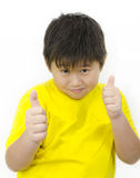 Thumbs up. A chinese boy with his thumb up over white background Stock Photo
