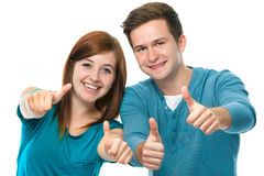 Thumbs up. Happy teens showing thumbs up Royalty Free Stock Image