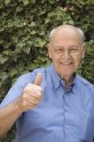 Thumbs up. Happy senior man giving thumbs up Royalty Free Stock Photos