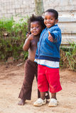 Thumbs Up. Two kids in the street showing a thumbs up to the photographer royalty free stock photo