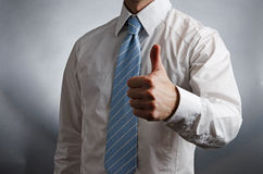Thumbs Up. Image of a man wearing a tie giving a thumbs up Stock Photography
