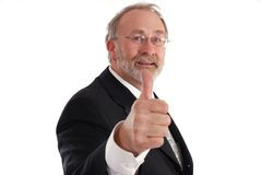 Thumbs up. Senior businessman giving the thumbs up Stock Images