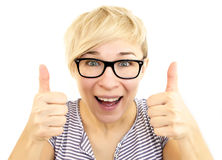 Thumbs up. Young woman showing thumbs up isolated on white background Royalty Free Stock Photography