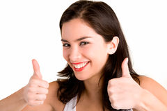 Thumbs Up. A beautiful brunette is showing her appreciation towards a job very well done Stock Photos